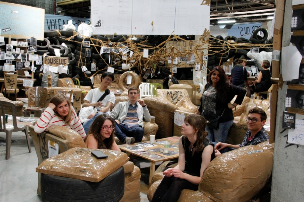 """The group in Thomas Hirschhorn's """"Flamme éternelle""""."""